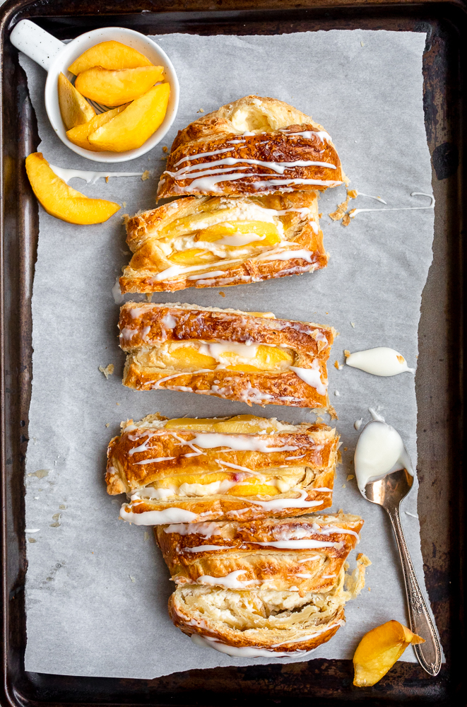 drizzling of peach with cream cheese danish